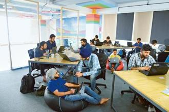 ShareChat's sparsely furnished Bengaluru office has an open floor plan with developers, designers and the community team clustered around wooden tables. Photos: Hemant Mishra/Mint
