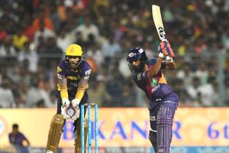 Pune Supergiants' Rahul Tripathi's sensational innings was studded with seven sixes, three off them coming in succession off chinaman Kuldeep Yadav in the 13th over to reduce the equation to 26 off the last 42 balls. He also struck nine fours. Photo: AFP