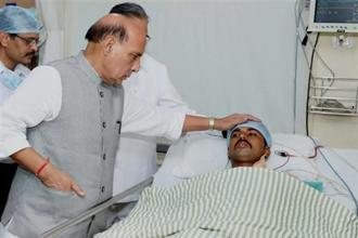 File photo: Home minister Rajnath Singh meets one of the injured CRPF personnel at a hospital in Raipur, a day after the Sukma Naxal attack. Photo: PTI