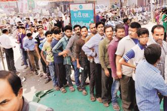 A file photo of a queue at an ATM during demonetisation. A low taxpayer base has for long been a key drag on the government's finances. Photo: PTI