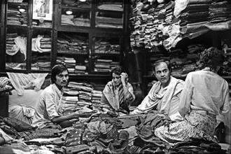Art critic Richard Bartholomew captured Martand Singh (centre) in a black and white frame at a fabric store in Jaipur in the 1970s. Photo: Courtesy The Estate of Richard Bartholomew.