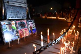 The candle light march, that went around the India Gate circle, saw people raising slogans hailing Ummer Fayaz's sacrifice. Photo: PTI