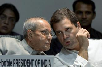 President Pranab Mukherjee with Congress vice president Rahul Gandhi during the launch of a commemorative volume on former prime minister Indira Gandhi in New Delhi on Saturday. Photo: PTI