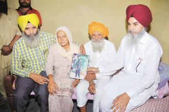 Family members of soldier Paramjeet Singh, who was killed on 1 May in Jammu and Kashmir. Photo: AFP
