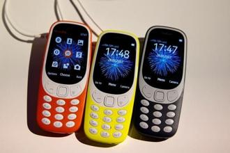 The new Nokia 3310 will come in four colours—warm red and yellow, both with a gloss finish, and dark blue and grey, both with a matte finish. Photo: Reuters
