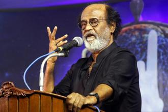 Rajini fans are eagerly waiting to see if their 'Thalaivar' will do an encore like MGR. Photo: PTI