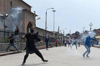 Kashmiri protestors throw stones towards forces during clashes in Srinagar. File Photo: AFP