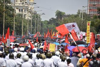 Left activists try to breach a police barrier during a march towards the state secretariat in Kolkata on Monday. Photo: Indranil Bhoumik/Mint