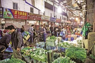 China's 1.4 billion people are building up an appetite that is changing the way the world grows and sells food, and forcing local companies to buy or lease farms abroad. Photo: Qilai Shen/Bloomberg