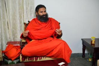 Baba Ramdev's Patanjali asked the govt that how can people feel and live 'Achchhe Din' without the right to good health. Photo: PTI