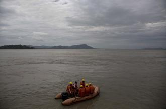 NDRF personnel patrol along the river Brahmaputra in Gauhati, on 30 May. Several northeastern states experienced heavy rainfall as an effect of tropical cyclone Mora that lashed southern Bangladesh on Tuesday. Photo: Anupam Nath/AP