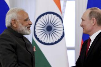 Indian Prime Minister Narendra Modi and Russian President Vladimir Putin during the latter's Russia visit on Thursday. Photo: AP