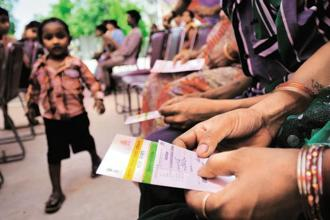 It has been also decided to link the Aadhaar number with the ration card issued to households availing the benefits or with the bank account for cash transfer benefit. Photo: Priyanka Parashar/Mint