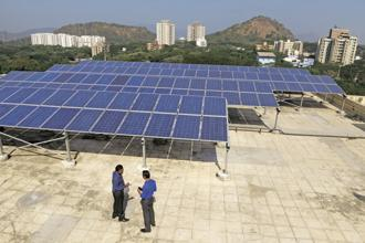 India's solar power generation capacity has already more than tripled in three years to over 12 GW as Prime Minister Narendra Modi targets raising energy generation from all renewable sources to 175 GW by 2022. Photo: Abhijit Bhatlekar/Mint
