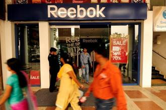 At present, Germany's Adidas AG sells Adidas and Reebok sports shoes and clothes in India. Photo: Pradeep Gaur/Mint