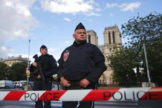 The assailant wounded one officer before he was shot and wounded by other officers. The Paris prosecutor's office swiftly began a counter-terrorism investigation. Photo: AP