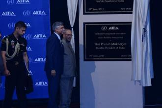President Pranab Mukherjee unveiled the commemorative plaque to mark the milestone and inaugurated the new building of AIMA.