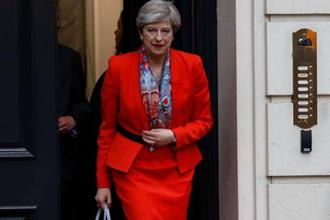 With no clear winner emerging from Thursday's election, a wounded Theresa May signalled she would fight on. Photo: Reuters