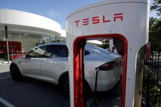 Tesla shares on Friday climbed for the fifth consecutive day and were headed for another record close. Photo: Reuters