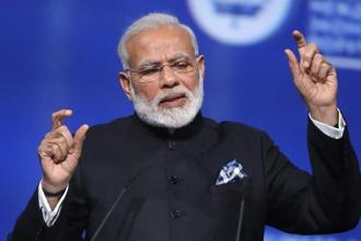 During his visit to France this month, PM Narendra Modi said India would 'go above and beyond' the Paris deal to protect climate for the future generations. Photo: Reuters
