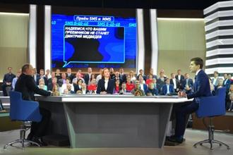 "Russian President Vladimir Putin answers questions at the Gostiny Dvor studio during the annual ""Direct Line with Vladimir Putin broadcast live"" in Moscow on 15 June. Photo: AP"