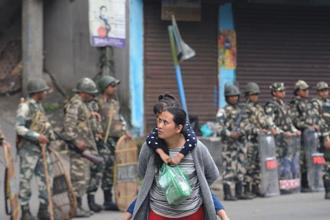 Paramilitary personnel stand guard during an indefinite strike called by the Gorkha Janmukti Morcha in Darjeeling on Friday. Photo: AFP