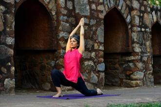Bindiya Sabherwal shows the Crescent Moon pose. Photo: Priyanka Parashar/Mint
