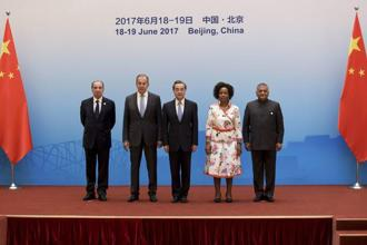 Brics members pose before the opening of the Brics foreign ministers' meeting in Beijing on Monday. Photo: AP
