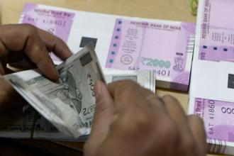 The rupee opened at 64.40 a dollar and touched a high and a low of 64.32 and 64.42 respectively. Photo: AFP
