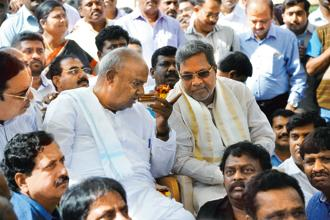 The Congress's miscalculations have damaged all efforts by CM Siddaramaiah (right) to get closer to JD(S) patriarch H.D. Deve Gowda and stop the BJP's onslaught in Karnataka. Photo: PTI