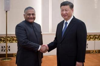 Minister of state for external affairs V. K. Singh (left) with Chinese President Xi Jinping in Beijing on Monday. Photo: Nicolas Asfouri/Reuters