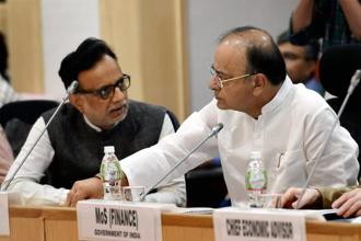Revenue secretary Hasmukh Adhia and finance minister Arun Jaitley at a GST Council meeting. Photo: PTI