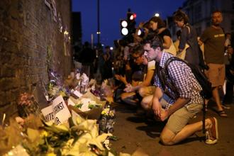A man looks at messages and tributes left near the place where a van attacked Muslims in Finsbury Park on Monday. Photo: Reuters