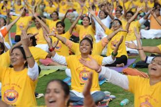 People perform yoga at the Kanteerava Stadium in Bengaluru. Hemant Mishra/Mint