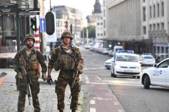 Belgian Army soldiers patrol outside Central Station after a reported explosion in Brussels on Tuesday. Photo: AP
