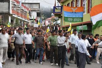 GJM supporters take out a rally during a protest in Darjeeling on Wednesday. Photo: PTI