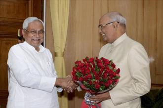 File photo. Bihar chief minister Nitish Kumar greets governor Ram Nath Kovind on being announced as NDA's presidential candidate, in Patna. Photo: PTI