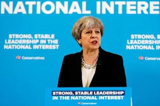 Theresa May on Wednesday unveiled a two-year program of government that contained eight new laws to help the UK unravel itself from EU membership.  Photo: Reuters