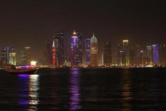 Buildings are seen on a coast line in Doha, Qatar. Photo: Reuters