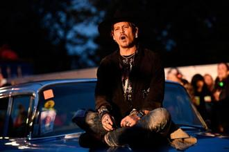 Johnny Depp poses on a Cadillac before presenting his film The Libertine during the Glastonbury Festival in Britain on 22 June. Photo: Reuters