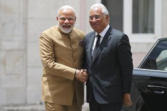 Prime Minister Narendra Modi (left) and Portuguese Prime Minister Antonio Costa shake hands at the Necessidades Palace, in Lisbon, Portugal on Saturday. Photo: AP