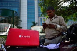 Flipkart is expected to pay slightly less than its preliminary offer of $1 billion to buy out Snapdeal, with the final deal value expected to be in the range of $700-900 million. Photo: Pradeep Gaur/Mint