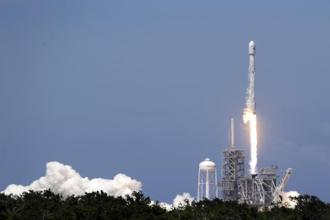 SpaceX's Falcon 9 rocket carrying a communications lifts off from pad 39A at the Kennedy Space Center in Cape Canaveral, Florida on Friday. Photo: AP