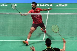 Kidambi Srikanth of India hits a return during the Australian Open men's singles badminton final with Chen Long of China in Sydney on Sunday. Photo: AFP
