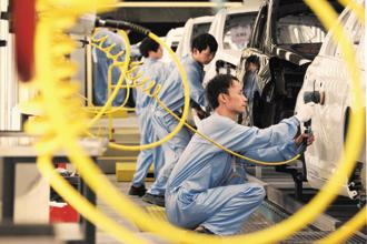 The earliest indicators for China's economy in June signal that the manufacturing sector may be poised to decelerate, while other challenges loom in the second half of this year. Photo: Bloomberg