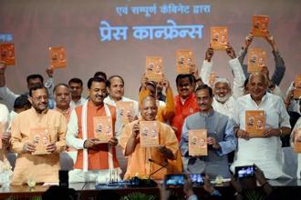 Yogi Adityanath unveiled a booklet called 100 din vishwas ke on his government's performance since he assumed office on 19 March. Photo: Nand Kumar/PTI