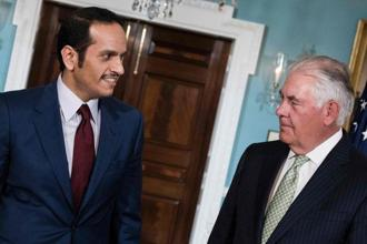 Qatar's foreign minister Mohammed bin Abdulrahman al-Thani (left) and US secretary of state Rex Tillerson stand together before a meeting at the US state department on 27 June in Washington, DC. Photo: AFP