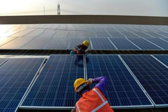 India has seen a significant decline in solar power tariffs from Rs10.95-12.76 per kWh in 2010-11. Photo: AFP