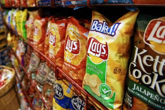 Potato chip makers, for instance, will now be taxed at 12% under GST, up from the effective tax rate of 5% under the current VAT regime. Photo: Bloomberg