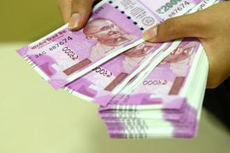 The rupee opened at 64.46 a dollar and touched a high and a low of 64.44 and 64.64, respectively. Photo: Mint